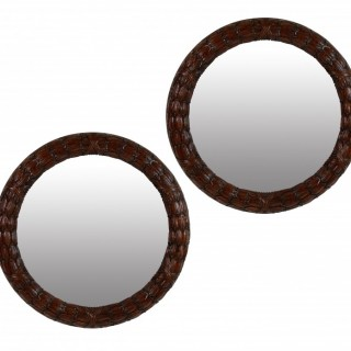 A PAIR OF FINE CIRCULAR MAHOGANY LAUREL MIRRORS