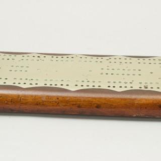 A large mahogany cribbage board Circa 1890