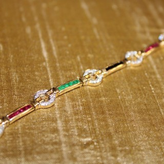 18ct Yellow Gold circular Diamond set bracelet with  Emerald, Ruby & Sapphire links, pre-owned