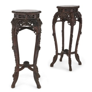 Pair of antique Chinese hardwood and veined marble stands