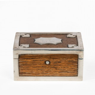 A silver mounted oak box from the ship's timbers of HMS Victor Emmanuel