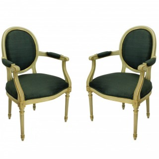 A PAIR OF FRENCH PAINTED & GILDED ARMCHAIRS