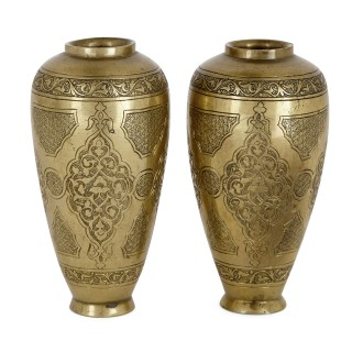 Pair of engraved antique brass vases by Salzmann