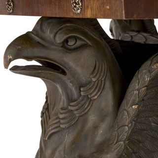 Mahogany octagonal table with bronzed metal griffins