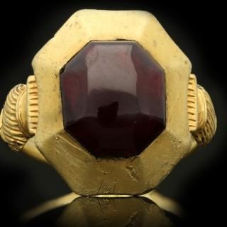 Medieval garnet cabochon ring, circa 1200-1400 century.