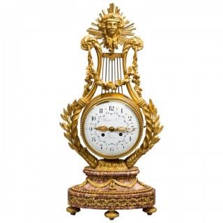 A Napoleon III Lyre clock with ormolu hands