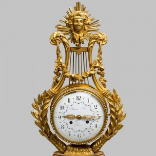 A Napoleon III Lyre clock with ormolu hands