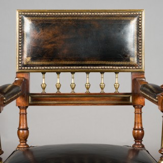 Matched Pair of 19th Century French Brass Mounted and Leather Armchairs