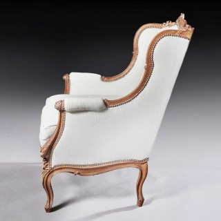 Finely Carved 19th Century French Louis XV Style Wing Armchair.