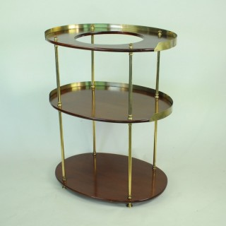 Three tier oval mahogany and brass wash stand