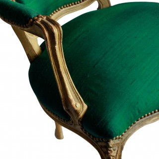 A PAIR OF 18TH CENTURY FRENCH ARMCHAIRS IN EMERALD SILK