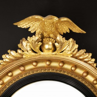 Regency Period Convex Mirror Surmounted with a Small Carved Eagle