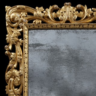 Charles II Giltwood Mirror with Asymmetrical Foliate Scrolls and Leaf Boarder