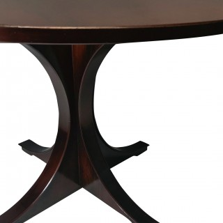 A MID-CENTURY ROSEWOOD DINING TABLE