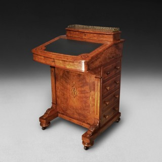 A Victorian inlaid Walnut and Crossbanded Davenport