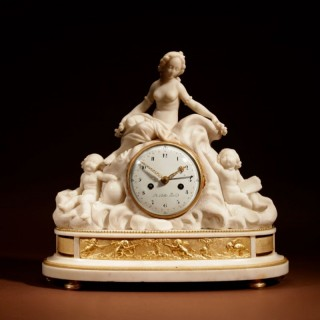 A French Louis XVI Period Large White Marble And Ormolu Pendule Mantel Clock With The Allegory of Love and Science.