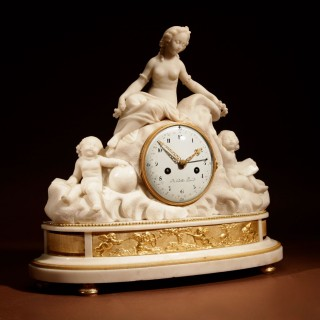 A French Louis XVI Period Large Sculpture White Marble And Ormolu Pendule Mantel Clock With The Allegory of Love and Science.
