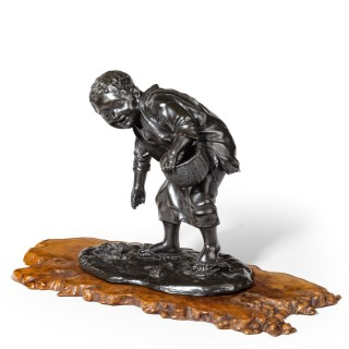 19th Century Meiji Period Bronze of a Boy Collecting Sweet Chestnuts by Seiya