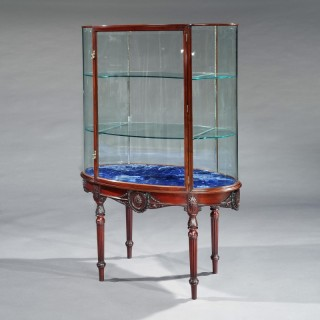A Display Cabinet in the Adam manner By F. Sage & Co