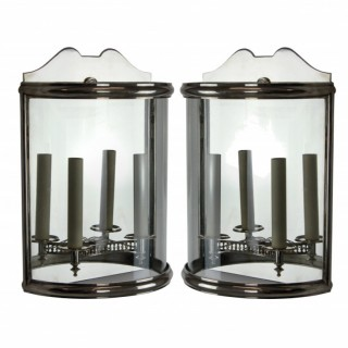 A PAIR OF SILVER DEMI LUNE WALL LANTERNS