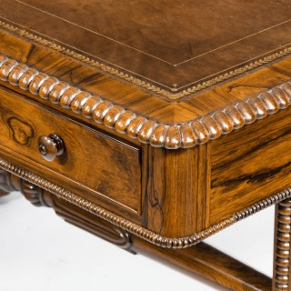 A late Regency rosewood free standing library table by James Winter