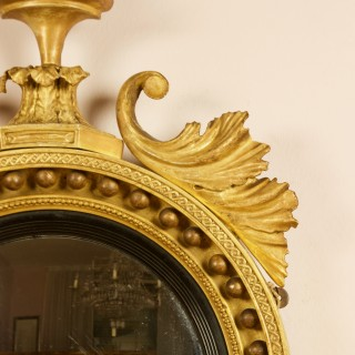Early 19th Century Regency Eagle Round Gilt and Ebonized Convex Wall Mirror