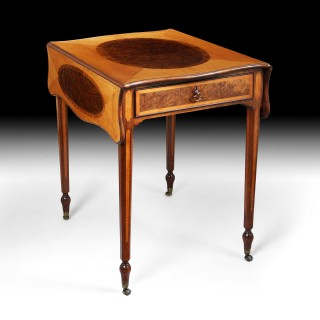 An exceptionally fine and rare George III satinwood and pollard oak Pembroke table .