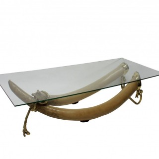A LARGE FAUX TUSK OCCASIONAL TABLE