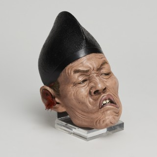 A set of three Japanese Iki Ningyo carved and lacquered wood realistic masks of shinto priests.