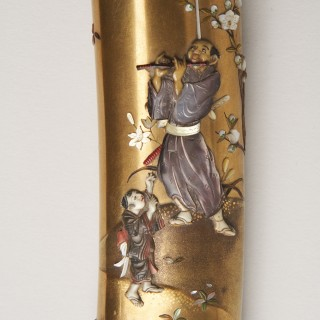 A Japanese Tanto with a gold lacquer sheath and handle inlaid with Shibiyama style decoration.