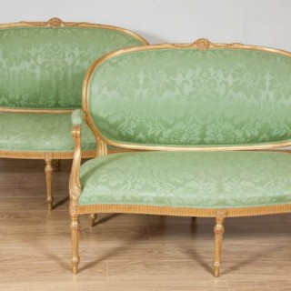 Pair of 18th century carved giltwood settees attributable to Thomas Chippendale