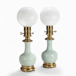 A 19th C pair of porcelain and ormolu mounted oil lamps by Gagneau, French