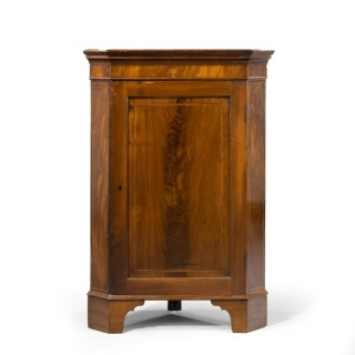 A Well Figured Floor Standing George III Period Corner Cupboard