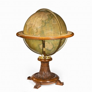 A 30 inch walnut terrestrial globe by W & AK Johnston of Edinburgh & London