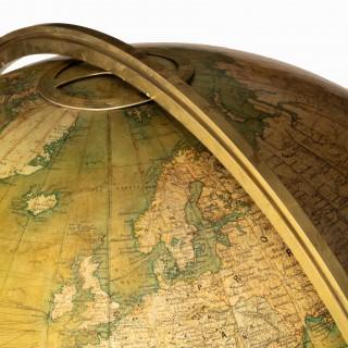 A 30 inch walnut terrestrial globe by W & AK Johnston of Edinburgh & London