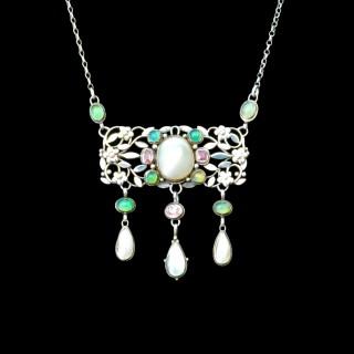 A silver pendant by Arthur and Georgie Gaskin