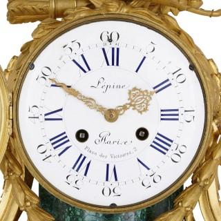 Antique French gilt bronze mounted malachite clock set