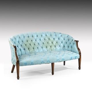 An Elegant Pair of Mid 20th Century Georgian Style Mahogany Framed Sofas