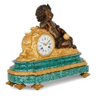 Neoclassical style malachite and gilt bronze mounted clock set