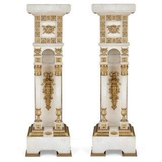 Neoclassical style white marble and gilt bronze pedestals