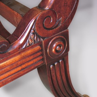 An unusual pair of Regency period mahogany sliding Library Armchairs.
