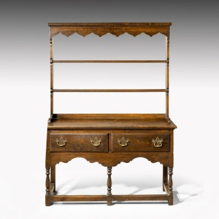 An Attractive Late 19th Century Oak Two Door George III Style Dresser