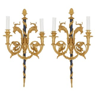 Pair of Rococo style gilt bronze two-light wall sconces