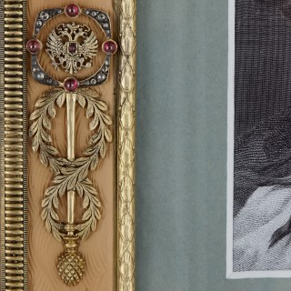 Gold and precious stone photograph frame in the style of Fabergé