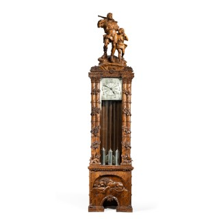 A 'Black Forest' linden wood long case clock by Spring of Interlaken