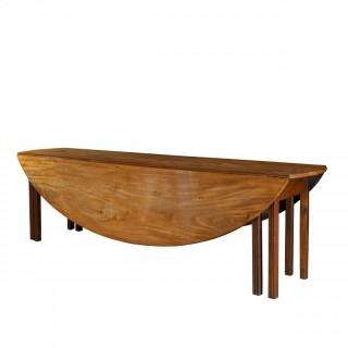 A long early George III Irish mahogany dining or wake table