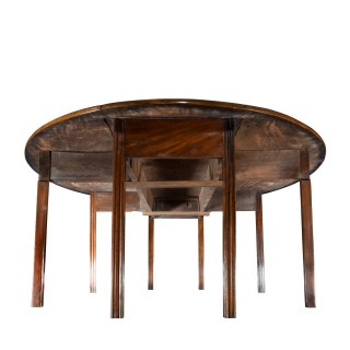 A long early George III Irish mahogany dining or wake table