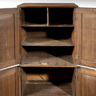 A Most Unusual Oak George III Period Two Section Cupboard