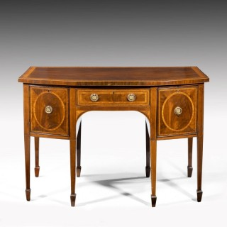 A George III Sheraton Period Mahogany Bow Front Sideboard