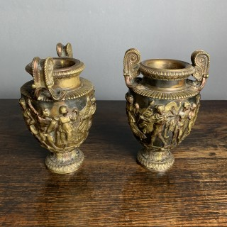 A Pair Of Classical And Decorated Gilt Urns